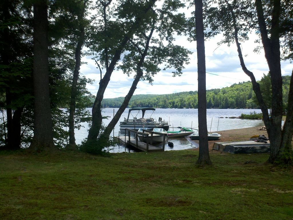 Waterfront view of Loon Lake with boats at dock.